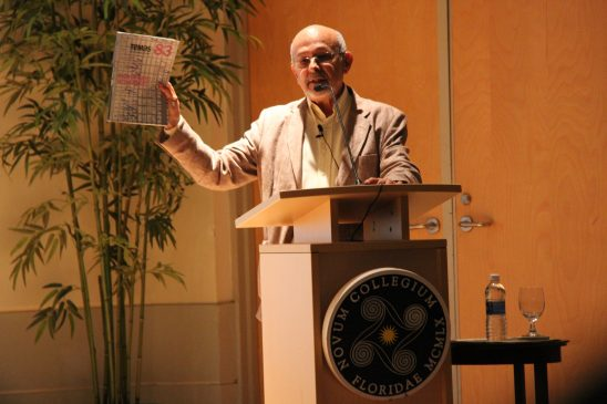 Dr. Rafael Hernández hold up a copy of Temas, a Cuban quarterly magazine.