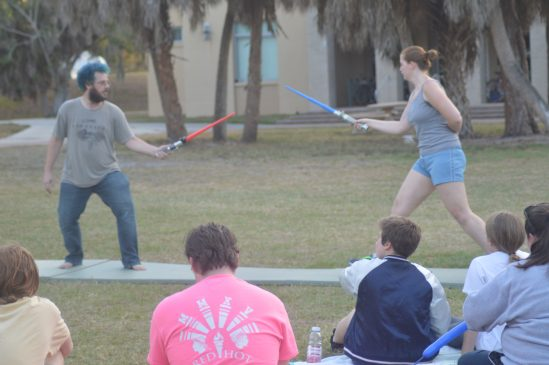 "Professor Shipman and thesis student Katherine Ervin dual it out ""Star Wars"" style."