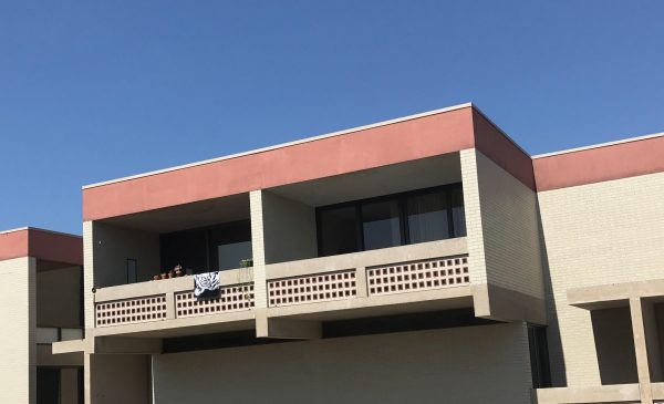 The balcony on the right has been used to test leaks. It has four sliding glass door panes as opposed to three.